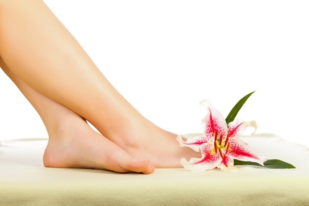 Women legs with flower enjoying cleanliness. Stock Photo - 20794652