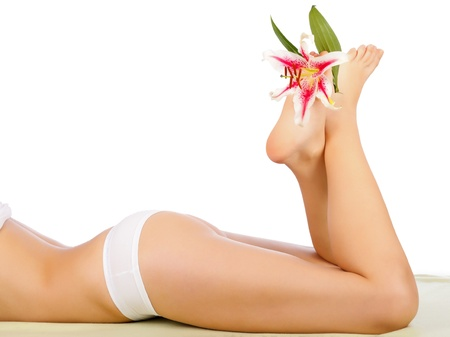 Beautiful Woman Body Lying With Legs Lifted Isolated. Stock Photo - 20794659
