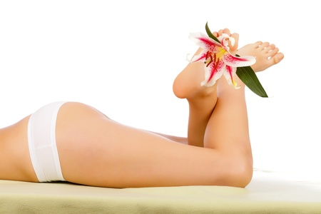 Beautiful Woman Body Lying With Legs Lifted Isolated. photo