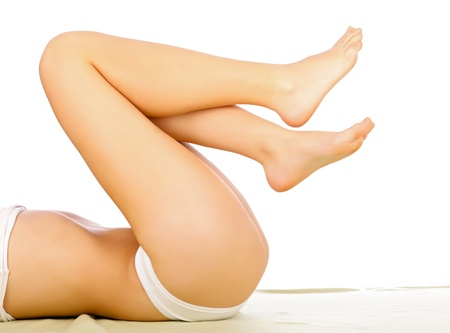 lifted: Woman Lying With Her Legs Lifted Isolated On White.