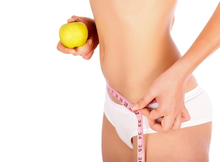 skinny woman: Young Woman With Apple and Measuring Tape.