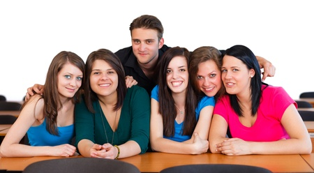 room mate: Happy smiling classmates together in classroom. Stock Photo