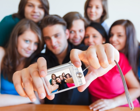 self expression: Young people taking picture of themselves with camera - selfpic series. Stock Photo
