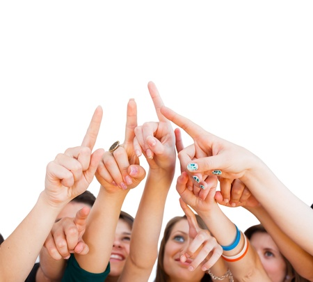 classmates: Young People Pointing Upwards To An Isolated Space. Stock Photo