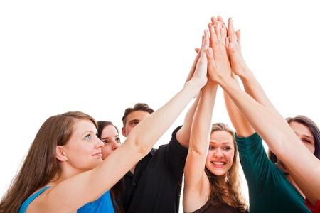 team spirit: Team members holding hands as symbol of unity.