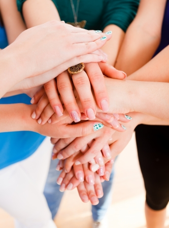 multinational: Hands of a group of people together forming a unity.