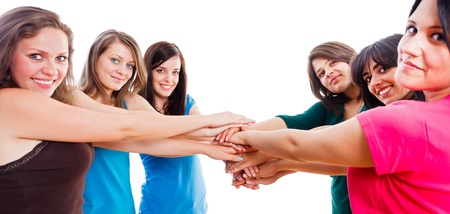 Group of beautiful successful team members hands together isolated on white.  photo
