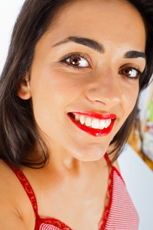 Portrait of a young girl with red lipstick at home. photo