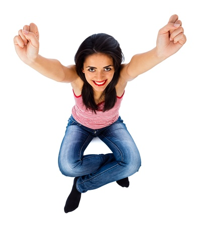 Excited young girl happy for her success - isolated. photo