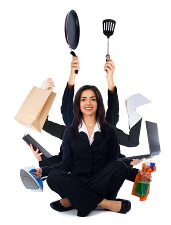 tasking: Beautiful happy woman sitting and multitasking - isolated on white. Stock Photo