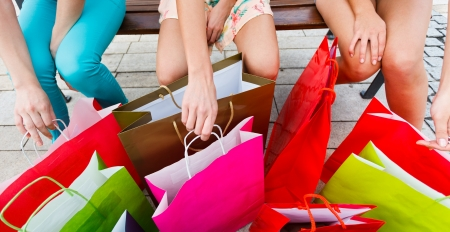 Lots of shopping bags and three girlsin the city. Stock Photo - 21145824