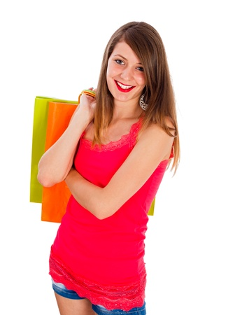 kindly: Cute girl smiling kindly with colorful shopping bag in her hands.