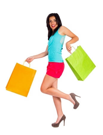 Pretty woman holding two shopping bags and smiling beautifully. photo