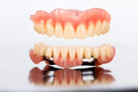 anchoring: A special closeup of a partial dental prosthesis made of acrylic and ceramic with special anchoring elements.