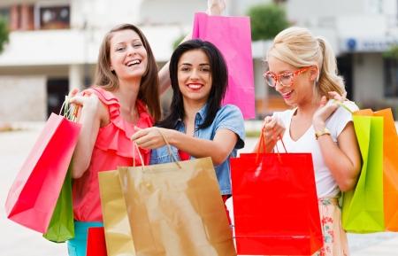 Beautiful girls enjoying their shopping time together. Фото со стока