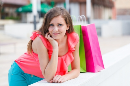 Beautiful woman relaxing after a shopping with shopping bags around her. Stock Photo - 21829773