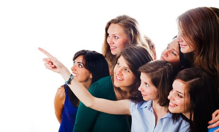 multinational: Young people showing towards an empty space isolated on white.