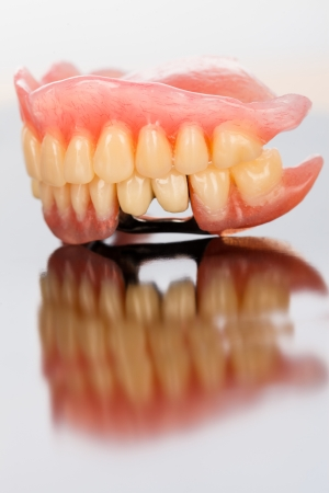 acryl: Total acrylic and skeletal partial prosthesis made of acryl and porcelain on mirror surface - right side. Stock Photo