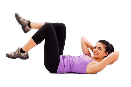 Pretty female fitness trainer doing warming up exercises.