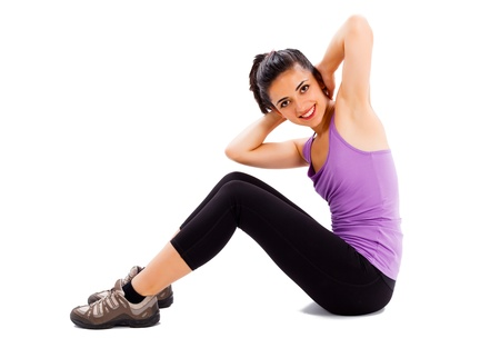 Beautiful young lady doing her every day fitness workout - isolated background. photo