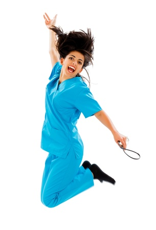 Happy female doctor jumping with stethoscope in hand - isolated on white.  photo