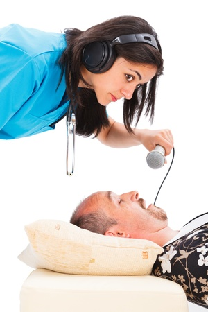 Doctor listening to a mans loud snoring through her headset - funny isolated image. photo