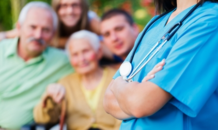 Confident doctor welcoming patients, happy family members - family medical care concept. Stock Photo - 21830193