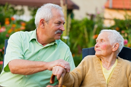 needy: Caring son saying goodbye to her mother when leaving the residential home. Stock Photo