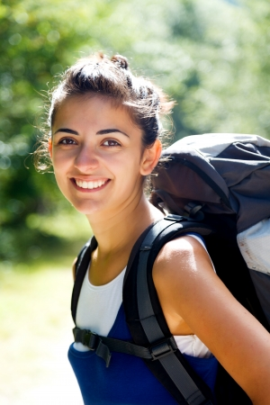 alpinist: Portrait of a woman hiker with backpack. Stock Photo