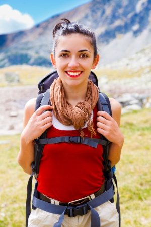 alpinist: Portrait of a woman hiker in the mountains.