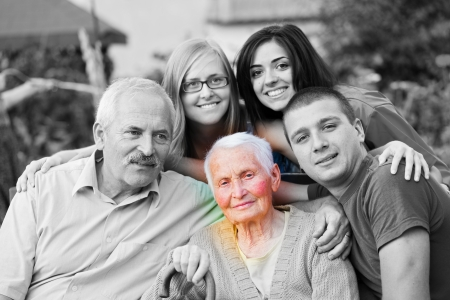 Alzheimer s concept - when the world closes in. An elderly woman surrounded by her family. photo