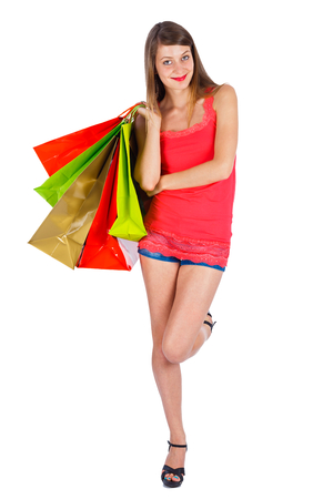 kindly: Beautifully looking young lady with many shopping bags smiling kindly.
