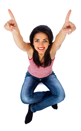 kindly: Kindly smiling young girl showing empty space with both her hands. Stock Photo