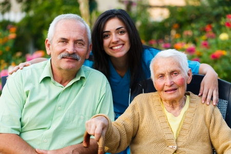 homecare: Family and doctor teaming up for the wellbeing of the senior woman.