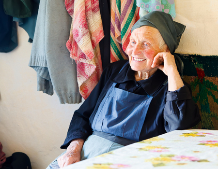 kindly: Elderly woman smiling kindly while telling a story.