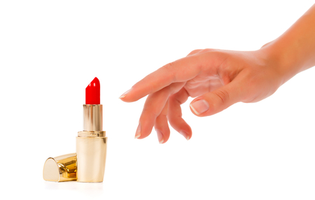reaching hand: Lady hand reaching elegantly after a red rouge - isolated on white.