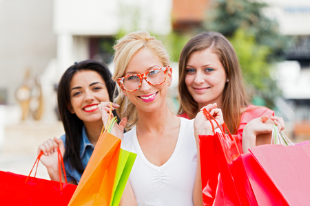 deserved: Attractive young women together for their well deserved shopping time.