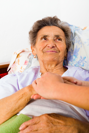 trust people: Care help love and trust to elderly people - holding hands.