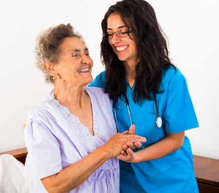 home care nurse: Happy nurses keeping good mood in nursing home.