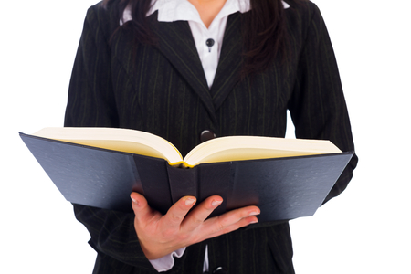 open  women: Holding open book or bible and reading carefully every word.