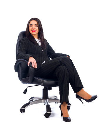 Kind boss woman sitting in office chair smiling. photo