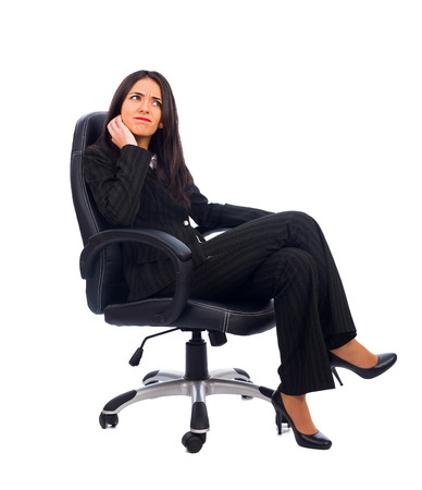 discontent: Discontent manager sitting with a dislike facial expression in office chair. Stock Photo