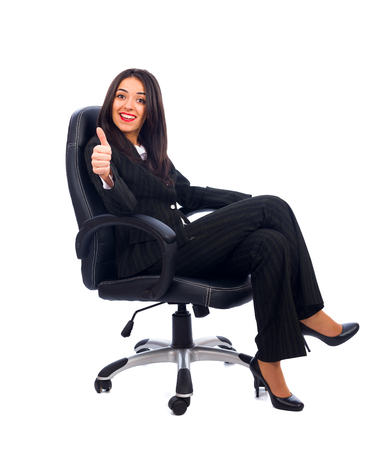 Satisfied CEO woman thumbs up, like for the new idea. photo