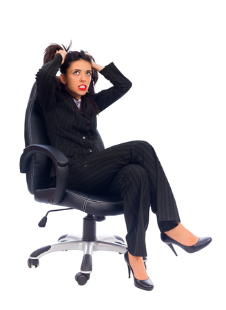 hysterics: Frustrated boss pulling out hair sitting is her chair.