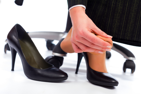 hurting: Wearing high heel shoes has its painful disadvantages - hurting feet, sole. Stock Photo