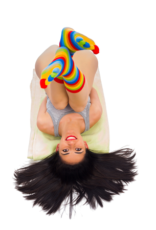 gleeful: Beautiful girl with colorful, striped socks smiling.
