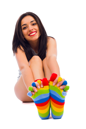 sincere girl: Sincere smile from a girl in warm colorful socks like her personality.