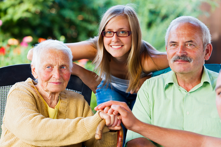 grand father: Elderly lady sitting with her son and granddaughter.
