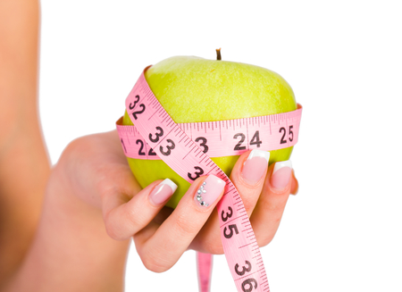 Fruit and measure tape as concepts of diet and healthy Life. photo