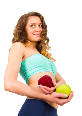 suggesting: Beautiful woman with fit body holding fresh frutis suggesting diet. Stock Photo